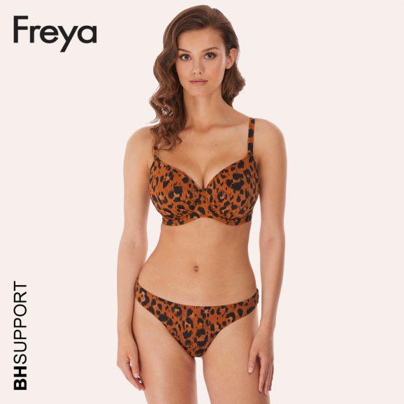 De in het oog springende Idol bikini top Roar Instinct, waarin een zwarte luipaardprint op een amberkleurige ondergrond de boventoon voert combineer je met een speels bikini broekje in dezelfde print of juist effen zwart.